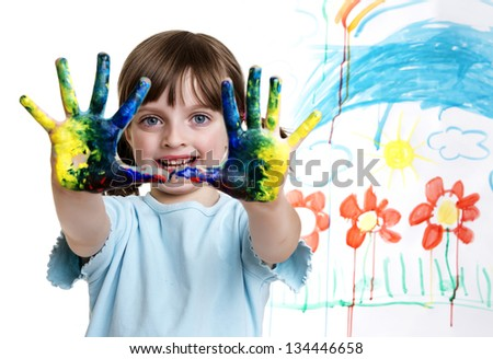 a little girl painting her happy picture - stock photo