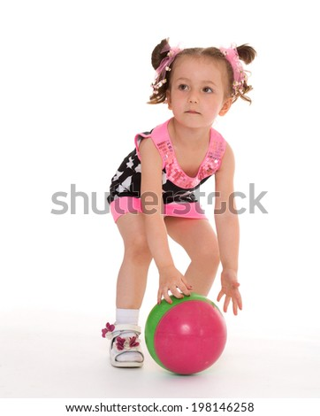 A little girl plays with the ball on white background - stock photo