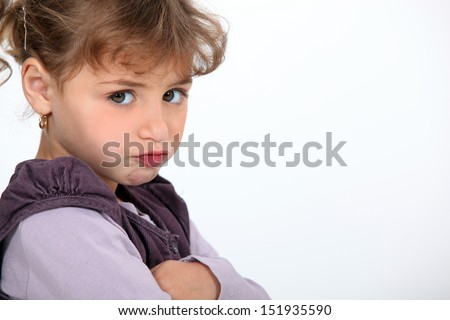 A little girl pouting. - stock photo