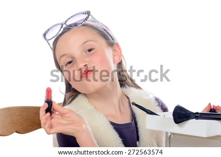 a little girl puts makeup of his mother on white - stock photo