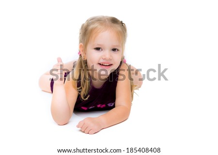 A little girl  showing thumbs up. Isolated on white background - stock photo
