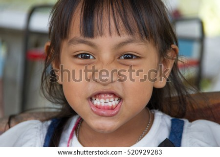 a little girl smiling joyfully