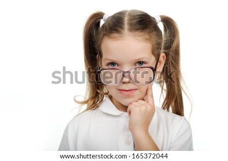 A little girl thinks. - stock photo