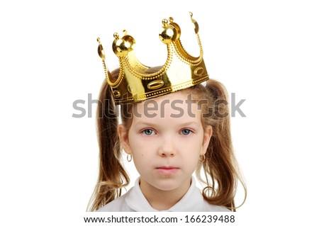 A little girl wears a crown. - stock photo