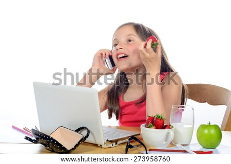 a little girl with a mobile phone on the white background - stock photo