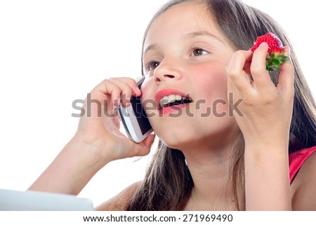 a little girl with a mobile phone on white background - stock photo
