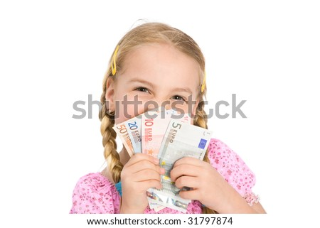 a little girl with money - stock photo