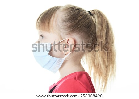 A Little girl with the protective mask - stock photo