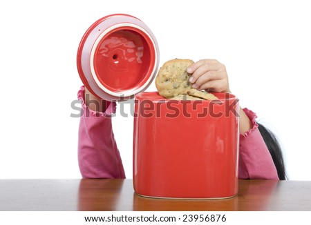 A little hand reaching into the cookie jar. - stock photo