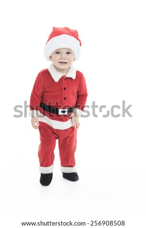 A little happy boy in santa hat portrait - stock photo