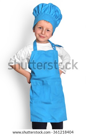 A little kid in a chef isolated on white background. - stock photo