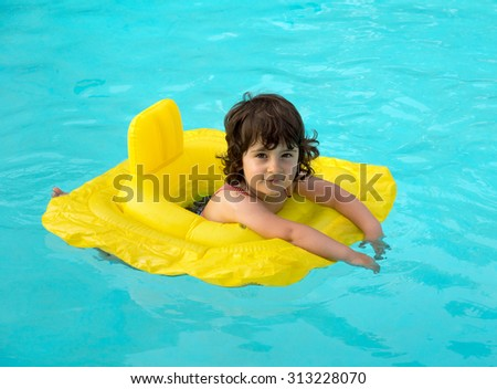 A little kid swimming in the pool - stock photo