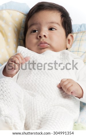 A little newborn latino baby in various poses.