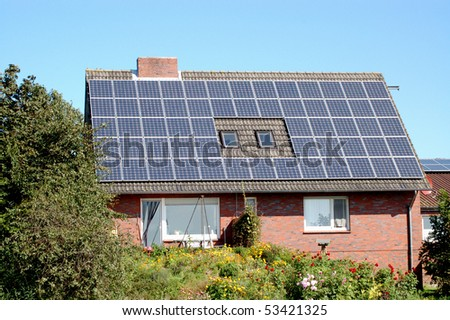 A little private house with solar panels - stock photo