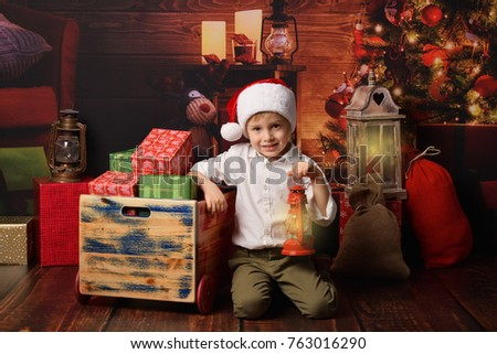 A little Santa Clause sitting on Christmas background.