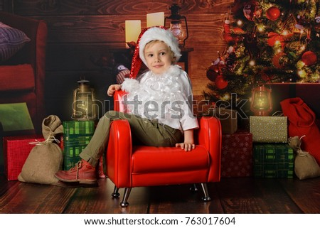 A little Santa Clause sitting on Christmas background