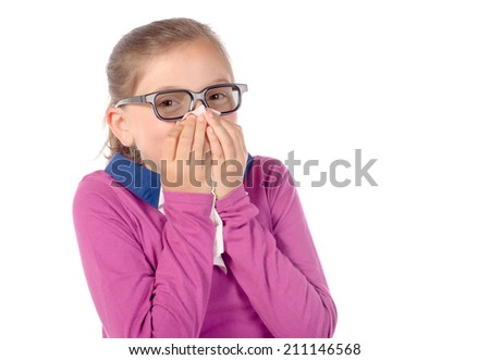 a little schoolgirl has a cold on white background - stock photo