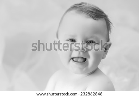a little smiling boy laughing - stock photo