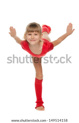 A little smiling gymnast shows an exercise - stock photo