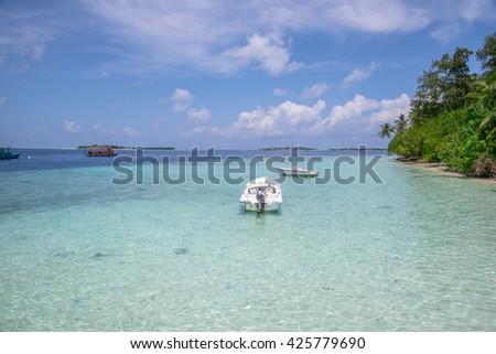A little speed boat in Maldives Beach Island resort. - stock photo