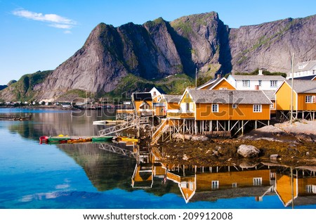 A little  village with tipical fishing houses on Lofoten islands, Norway - stock photo