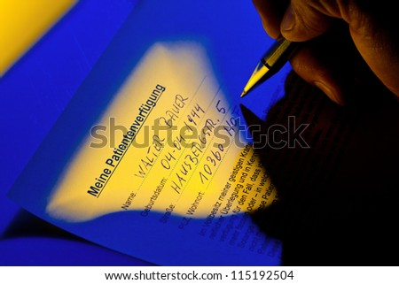 a living will is written by a patient. - stock photo