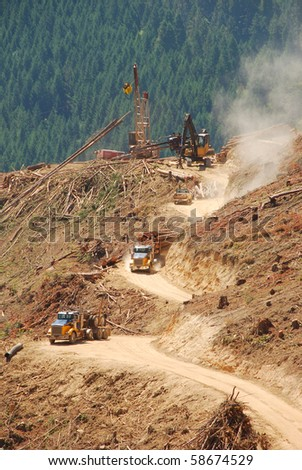 "A loaded log truck  on a logging operation or ""side"" in the foothills of the Cascade Mountains in southern Oregon - stock photo"