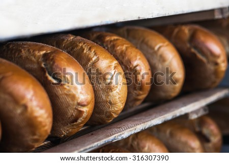 a loaf of bread on the shelf for bread factory - stock photo