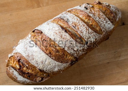 A loaf of fresh cranberry walnut bread
