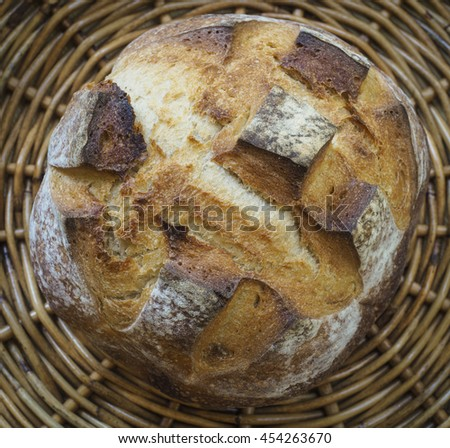 A loaf of rustic sourdough bread. - stock photo