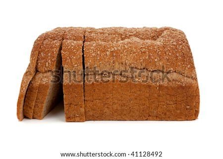 A loaf of sliced wheat bread on a white background