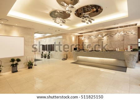 A lobby(lounge) with lighting, marble bottom, information at the hotel in seoul, korea.