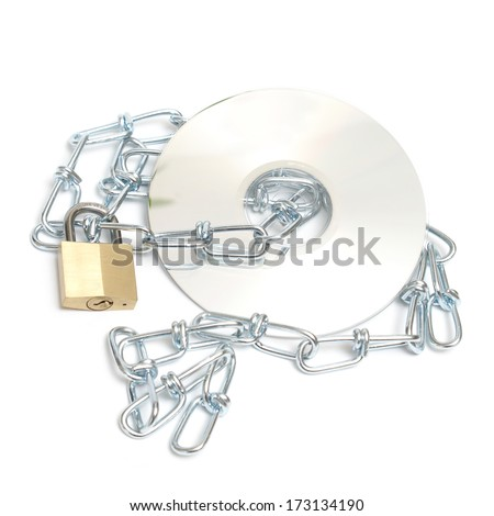 A lock and chain safeguard a data disk from any theft or copyright. - stock photo