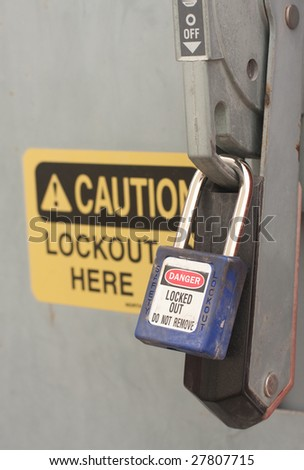 A lock-out tag-out procedure being followed correctly