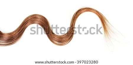 A lock wavy brown hair isolated on white background. - stock photo