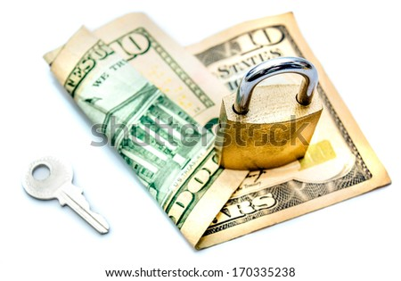 A locked padlock on top of a 10 dollar note isolated on white - stock photo