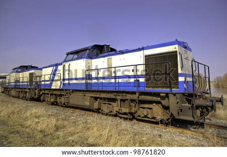 A locomotive with blue and white colors at a shining day in spring in Riesa, East-Germany - stock photo