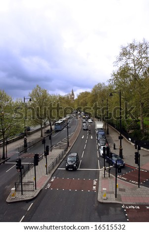 a london city street scene with big ben in the background - stock photo