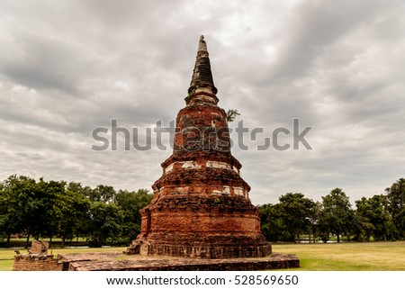 A lone Chedi (Pagoda) beneath a stormy sky in Auytthaya, Thailand