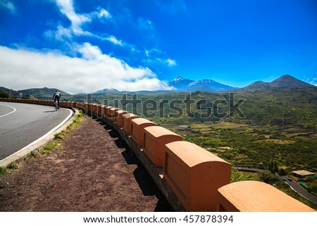 a lone cyclist on the road near Valle de Arriba, Tenerife, Canary Islands, Spain