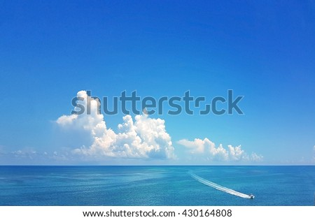 A lone motor boat has the ocean to itself, in the beautiful Caribbean water of the Florida Keys - stock photo