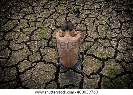A lone poor children in the arid area - stock photo
