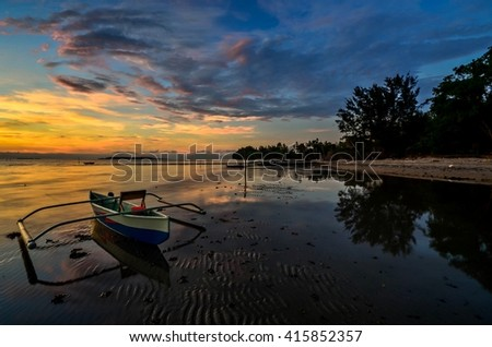 A lonely boat and a beautiful sunrise at kampung Nagalang Labuan, Malaysia.
