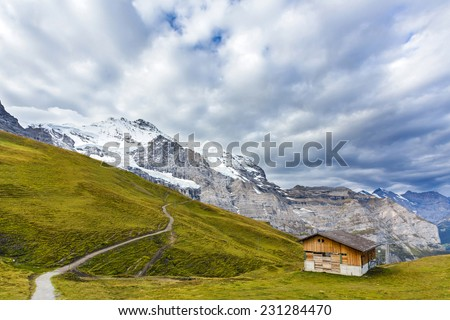 A lonely house on snowy mountains - stock photo
