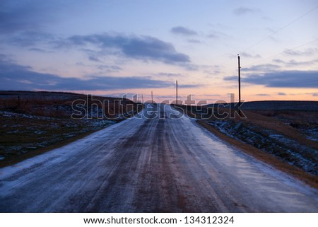 A lonely icy road in the Midwest