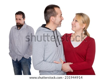 a lonely man behind a lovely couple - stock photo
