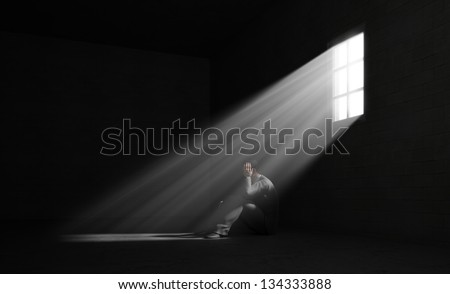 Dark Room With A Light Shining On A Person Silhouette