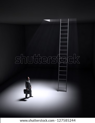 A lonely man standing in a spot of light coming from an opening in the ceiling