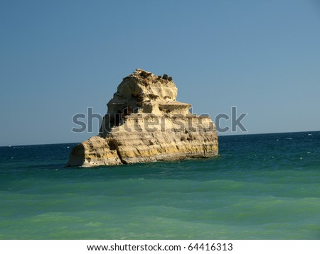 A lonely rock in the ocean. The effect of erosion