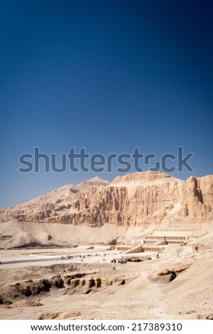 A long distance view of the Mortuary Temple of Queen Hatshepsut on the west bank of the Nile near to the Valley of the Kings. - stock photo
